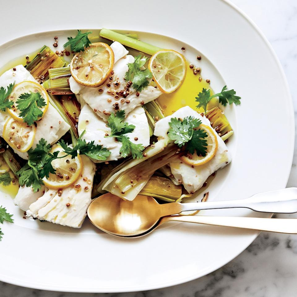 """Slow-roasting <a href=""""https://www.epicurious.com/ingredients/it-s-time-to-cook-some-halibut-gallery?mbid=synd_yahoo_rss"""">halibut</a> and leeks in olive oil is one of the easiest, most elegant ways to serve fish. Look for a thick, center-cut piece of halibut. <a href=""""https://www.epicurious.com/recipes/food/views/-halibut-confit-with-leeks-coriander-and-lemon-51252690?mbid=synd_yahoo_rss"""">See recipe.</a>"""