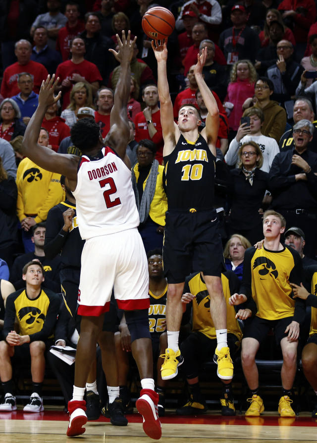 Iowa guard Joe Wieskamp (10) shoots the winning basket over Rutgers center Shaquille Doorson (2) during the second half of an NCAA college basketball game Saturday, Feb. 16, 2019, in Piscataway, N.J. Iowa won 71-69. (AP Photo/Adam Hunger)