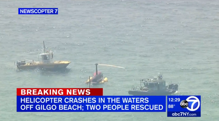 A helicopter carrying Shane McMahon bobs in waters off Long Island. (via screenshot)