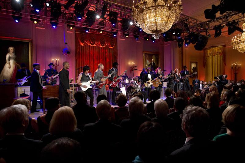 President Barack Obama and first lady Michelle Obama, listen as B.B. King, center, and others perform during the White House Music Series saluting Blues Music in recognition of Black History Month, Tuesday, Feb. 21, 2012, in the East Room of the White House in Washington. (AP Photo/Pablo Martinez Monsivais)