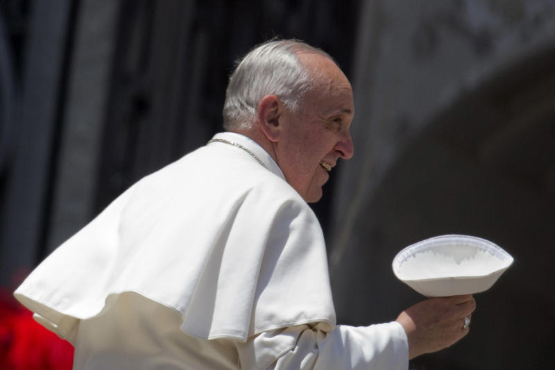 """In this May 29, 2013 file photo, Pope Francis holds his skull-cap as he leaves at the end of his weekly general audience, in St. Peter's Square, at the Vatican. Since his March 2013 election, Pope Francis has started a revolution in the Roman Catholic church that charmed millions and the mainstream media, as he goes about doing what he was elected to do: reform not just the dysfunctional Vatican bureaucracy but the church itself, using his own persona and personal history as a model. But the enthusiasm isn't necessarily shared across the board. Traditionalist Catholics — so coddled by Benedict XVI in his pursuit to reach out to Catholics attached to the old Latin Mass and opposed to the modernizing reforms of the Second Vatican Council — greeted Francis' election with concern and now have had their worst fears realized. Francis has spoken out both publicly and privately against such """"restoratist groups"""" whom he accused of being naval-gazing retrogrades out of touch with the evangelizing mission of the church in the 21st century. (AP Photo/Andrew Medichini)"""