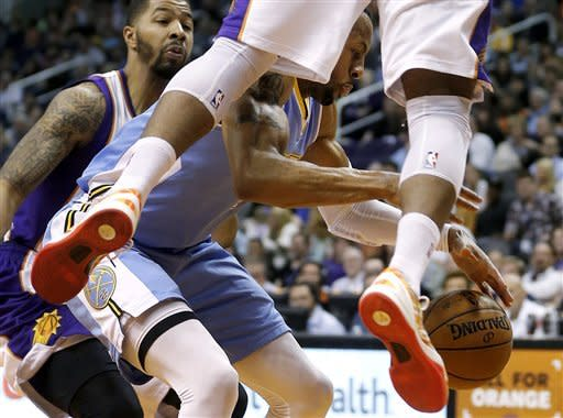 Denver Nuggets' Andre Iguodala chases a loose ball as Phoenix Suns' Markieff Morris, left, and P.J. Tucker defend during the first half of an NBA basketball game, Monday, March 11, 2013, in Phoenix. (AP Photo/Matt York)