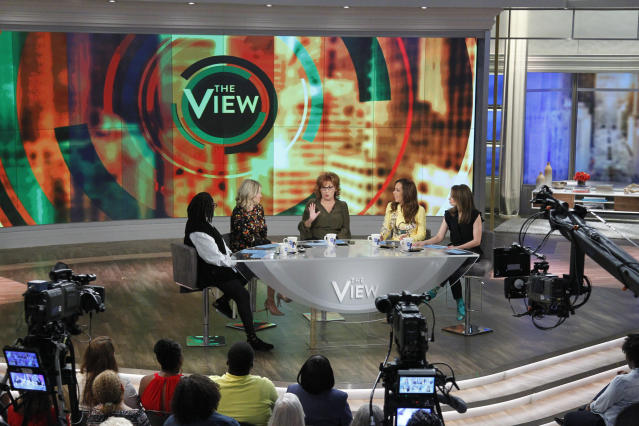 """Bilasits across the table from longtime """"View"""" co-host Whoopi Goldberg. (Lou Rocco via Getty Images)"""