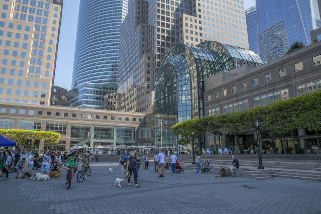 <p>People walk through the courtyard just outside of Brookfield Place (originally known as the World Financial Center) in lower Manhattan on Aug. 13, 2017. (Photo: Gordon Donovan/Yahoo News) </p>