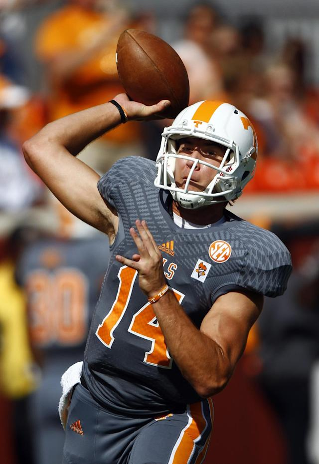 Tennessee quarterback Justin Worley (14) throws during warm-ups before an NCAA college football game against Georgia on Saturday, Oct. 5, 2013, in Knoxville, Tenn. (AP Photo/Wade Payne)