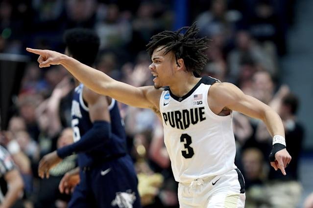 <p>Carsen Edwards #3 of the Purdue Boilermakers celebrates a three point basket against the Villanova Wildcats in the second half during the second round of the 2019 NCAA Men's Basketball Tournament at XL Center on March 23, 2019 in Hartford, Connecticut. (Photo by Rob Carr/Getty Images) </p>