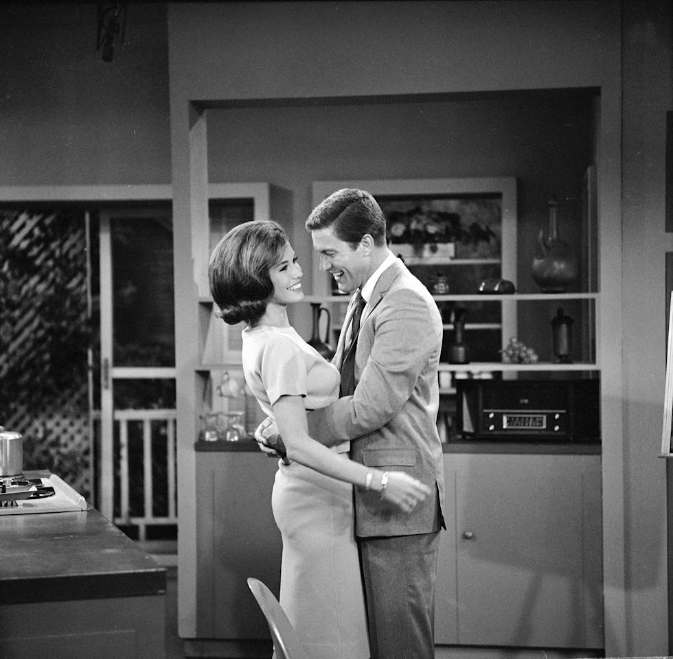 "LOS ANGELES - SEPTEMBER 11: THE DICK VAN DYKE SHOW episode ""What's in a Middle Name?"" featuring Mary Tyler Moore (Laura Petrie) and Dick Van Dyke (Rob Petrie). Image dated September 11, 1962.  (Photo by CBS via Getty Images)"