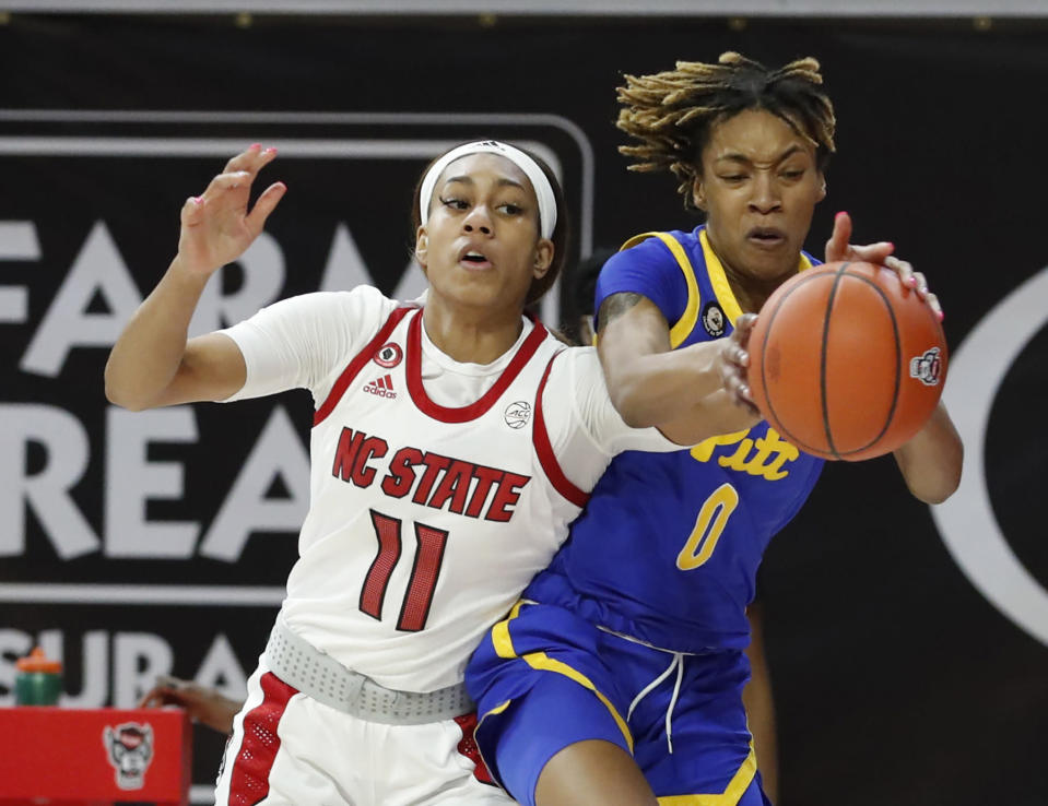 Pittsburgh's Sandrine Clesca (0) pulls the rebound from North Carolina State's Jakia Brown-Turner (11) during the first half of an NCAA college basketball game, Thursday, Feb. 25, 2021 in Raleigh, N.C. (Ethan Hyman/The News & Observer via AP, Pool)