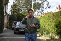 Myanmar's ambassador to the United Kingdom, Kyaw Zwar Minn, gestures to the media outside his residence in London, Thursday, April 15, 2021. The Myanmar ambassador who has criticized the military coup in his country is due to be evicted from the property after the embassy was taken over by diplomats loyal to the military regime last Wednesday. (AP Photo/Alberto Pezzali)