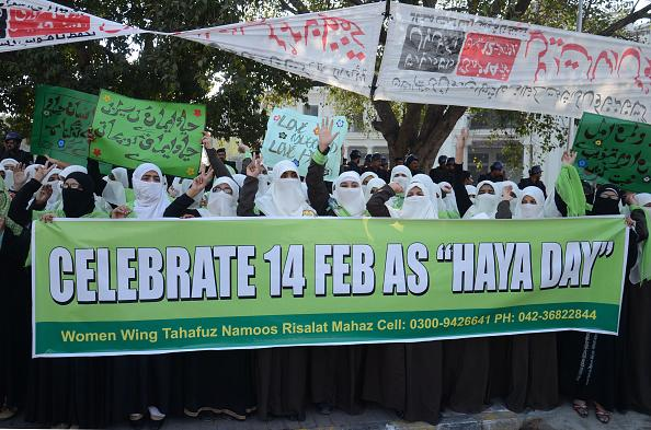 <p>Pakistani female supporters of the religious group Naeemian Association Women Wing, Tahafuz Namoos Risalat Mahaz women wing chant slogans and hold placards during a protest demonstration rally to condemn of St.Valentine's Day celebrations. There are some among the Muslim community who feel that the event is un-Islamic. Photo – Getty </p>