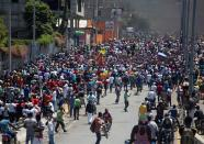 Demonstrators march during a protest against the government of President Jovenel Moise, in Port-au-Prince