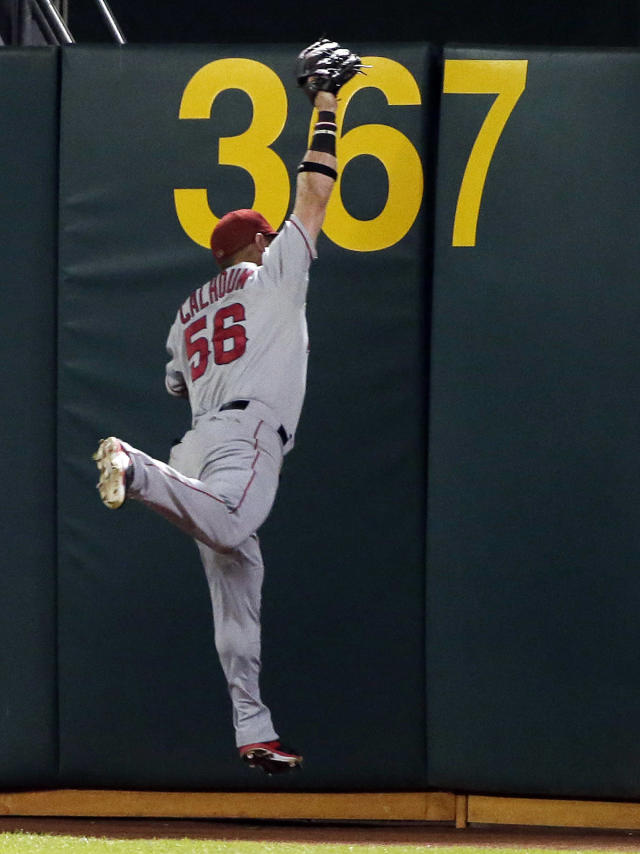 Los Angeles Angels right fielder Kole Calhoun makes a leaping catch on a pop fly from Oakland Athletics' Coco Crisp during the sixth inning of a baseball game Friday, Aug. 22, 2014, in Oakland, Calif. (AP Photo/Marcio Jose Sanchez)