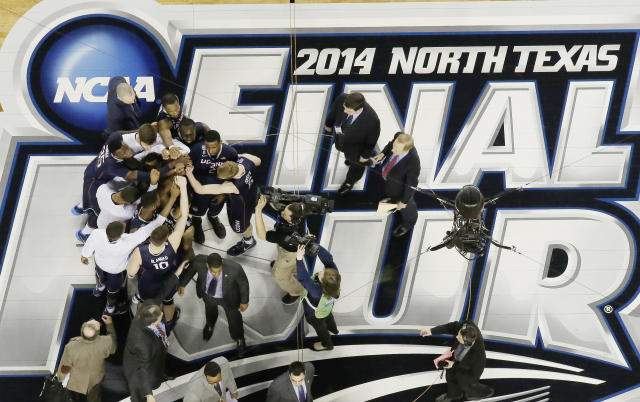 Connecticut gathers on the floor after beating Florida 63-53 at their NCAA Final Four tournament college basketball semifinal game Saturday, April 5, 2014, in Arlington, Texas. (AP Photo/David J. Phillip)