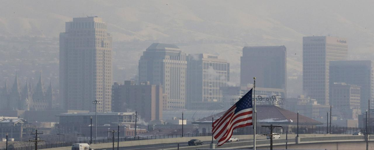 FILE - This Jan. 4, 2013, file photo, shows the haze from an inversion hanging over downtown Salt Lake City. The geography that makes Utah one of the world's most beautiful places also brings the nation's dirtiest air in winter, when an icy fog smothers mountain valleys for days or weeks at a time. A group of doctors is declaring a health emergency over northern Utah's lingering pollution problem. Utah Physicians for a Healthy Environment planned to deliver a petition Wednesday demanding immediate action by elected officials. The group wants Gov. Gary Herbert and mayors of northern Utah cities to cut the pollution. (AP Photo/Rick Bowmer)