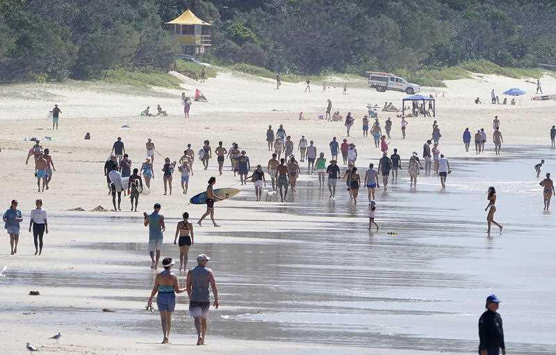 Crowds are seen at Burleigh Beach on the Gold Coast.