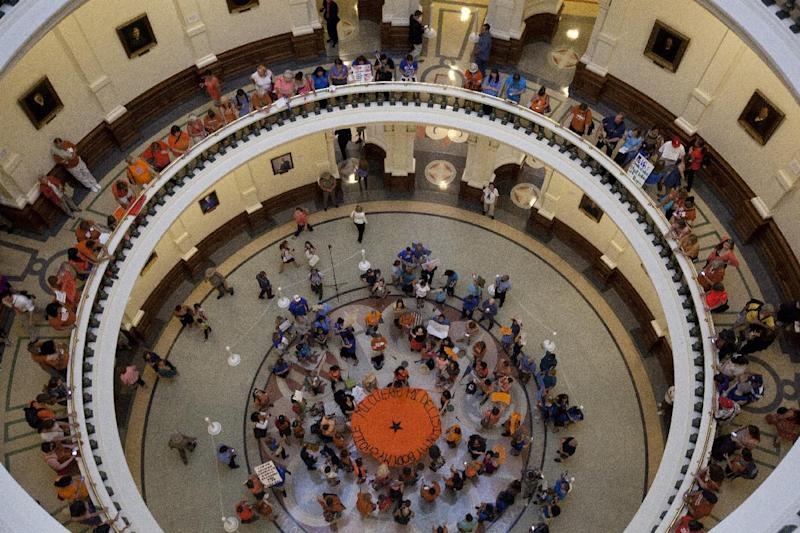 Opponents and supporters of abortion rights gather in the State Capitol rotunda in Austin, Texas on Friday afternoon, July 12, 2013. The Texas Senate's leader, Lt. Gov. David Dewhurst, has scheduled a vote for Friday on the same restrictions on when, where and how women may obtain abortions in Texas that failed to become law after a Democratic filibuster and raucous protesters were able to run out the clock on an earlier special session. (AP Photo/Tamir Kalifa)