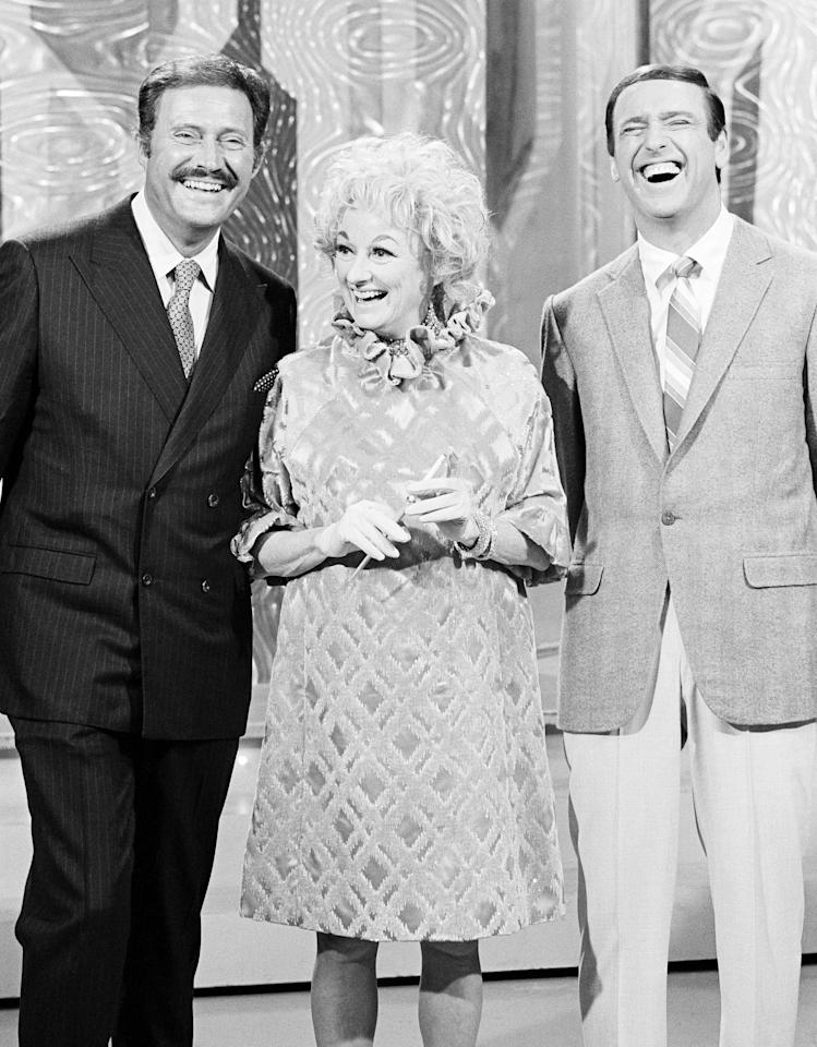 """Host Dan Rowan, Phyllis Diller, host Dick Martin on the set of 'Rowan and Martin's Laugh In"""", Nov. 25, 1968. (Photo by NBCU Photo Bank/Getty Images)"""