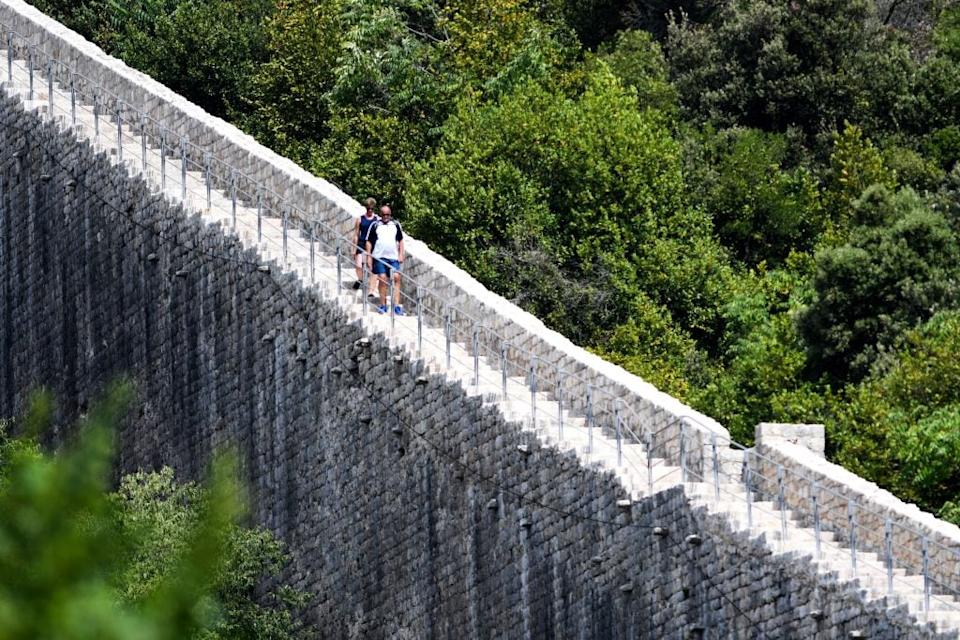 A pair of tourists explore the walls of Ston - getty