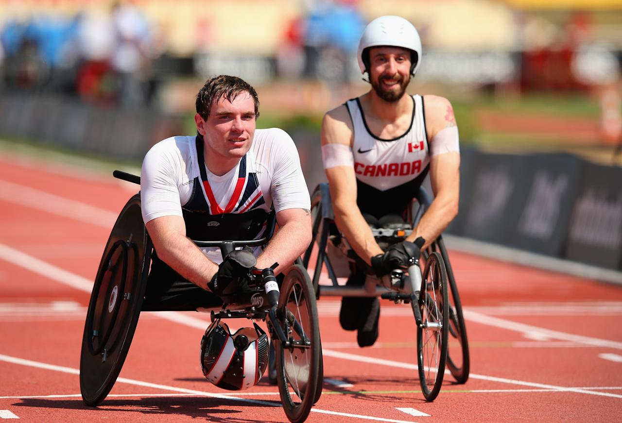 LYON, FRANCE - JULY 25: Mickey Bushell of Great Britain with Brent Lakatos of Canada after the Men's 100m T53 semi final during day six of the IPC Athletics World Championships on July 25, 2013 in Lyon, France. (Photo by Julian Finney/Getty Images)