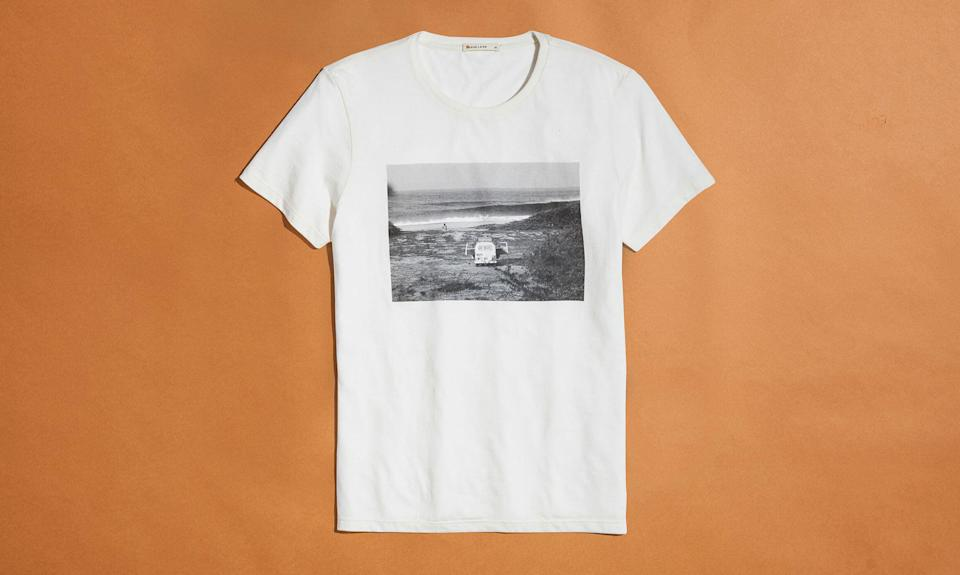 """<p>ML x L&F Tee, $45, <a rel=""""nofollow noopener"""" href=""""https://www.marinelayer.com/collections/guys-new/products/marley-graphic-tee-pristine-off-white-6?variant=3605005139994"""" target=""""_blank"""" data-ylk=""""slk:marinelayer.com"""" class=""""link rapid-noclick-resp"""">marinelayer.com</a> </p>"""