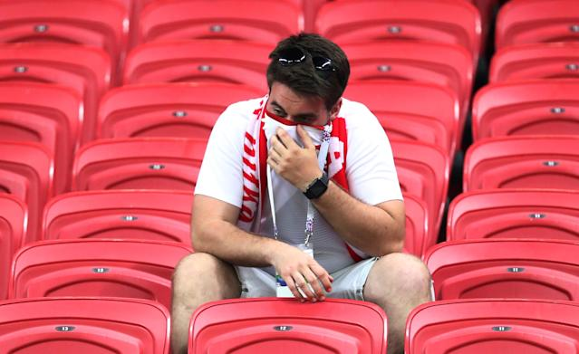 Soccer Football - World Cup - Group H - Poland vs Colombia - Kazan Arena, Kazan, Russia - June 24, 2018 Poland fan looks dejected after the match REUTERS/Sergio Perez