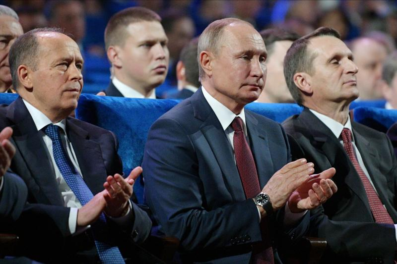 President Vladimir Putin, center, Federal Security Service (FSB) Director Alexander Bortnikov, left, and Sergei Naryshkin, head of the Russian Foreign Intelligence Service, right, attend the meeting with intelligence officers on their professional holiday in Moscow, Russia, Thursday, Dec. 19, 2019. Russia marked its Day of Employees of State Security Agencies on Thursday. (Alexei Druzhinin, Sputnik, Kremlin Pool Photo via AP)