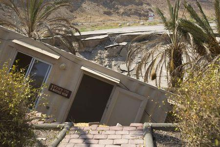 A structure that collapsed into a sinkhole is seen at an abandoned tourist resort on the shore of the Dead Sea, Israel July 28, 2015. REUTERS/Amir Cohen
