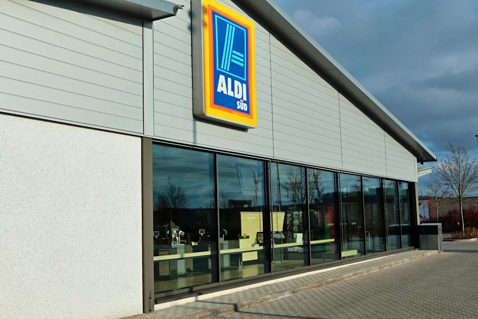 Amberg, Germany - January 14, 2018: ALDI store in Amberg, Bavaria, Germany, Europe. ALDI is a german discount market chain with headquarter in Mühlheim an der Ruhr, Germany. Logo of ALDI SÜD on the facade. Sunday morning - no people in the store.