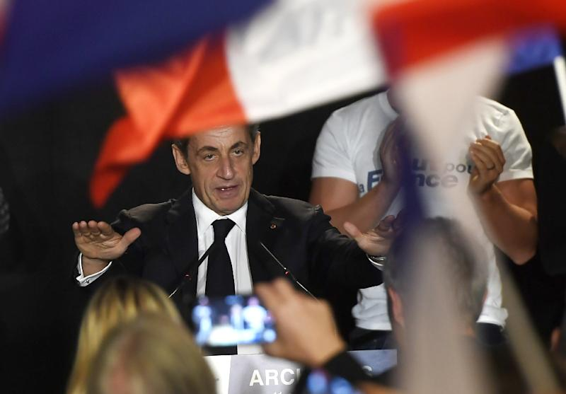 Former French president Nicolas Sarkozy beats a populist drum with his tough talk on immigration, security and national identity (AFP Photo/Philippe Desmazes)