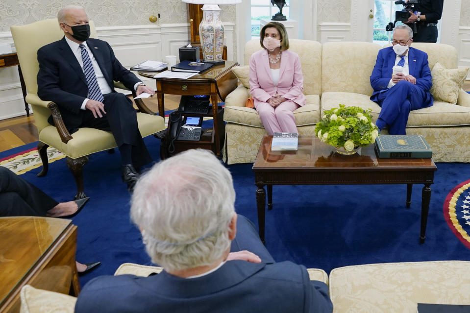 President Joe Biden speaks during a meeting with congressional leaders in the Oval Office of the White House, Wednesday, May 12, 2021, in Washington. Clockwise from left, Vice President Kamala Harris, Biden, House Speaker Nancy Pelosi of Calif., and Senate Majority Leader Chuck Schumer of N.Y., and Senate Minority Leader Mitch McConnell of Ky. (AP Photo/Evan Vucci)