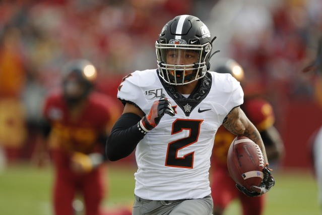 "Oklahoma State WR <a class=""link rapid-noclick-resp"" href=""/ncaaf/players/280519/"" data-ylk=""slk:Tylan Wallace"">Tylan Wallace</a> is far and away the team's leading receiver in 2019. (AP Photo/Matthew Putney)"
