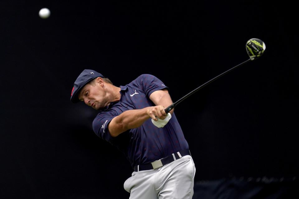 Bryson DeChambeau plays his shot from the seventh tee during the third round of the U.S. Open Golf Championship, Saturday, June 19, 2021, at Torrey Pines Golf Course in San Diego. (AP Photo/Gregory Bull)