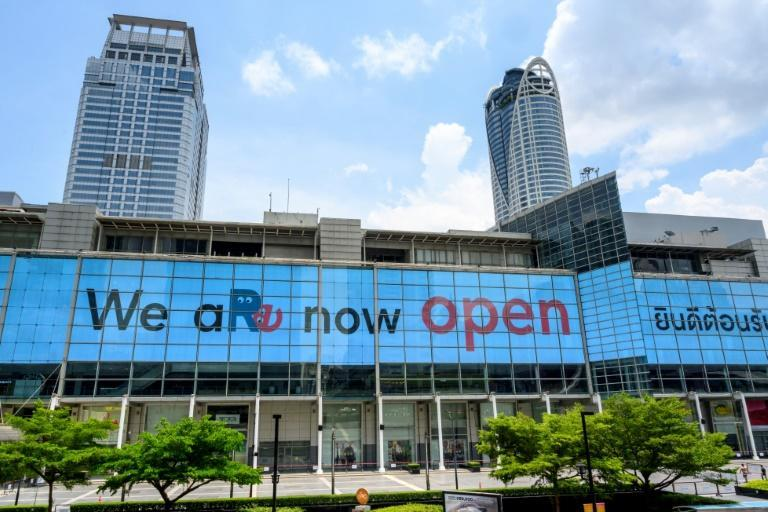 A giant screen welcomes visitors to the Central World shopping mall in Bangkok after virus restrictions were lifted