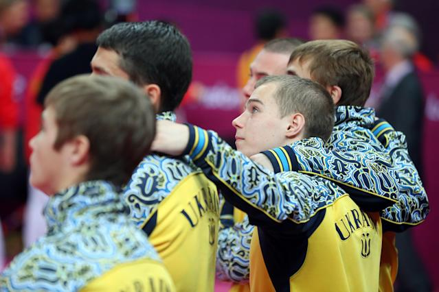 LONDON, ENGLAND - JULY 30: Team Ukraine reacts after the end of the Artistic Gymnastics Men's Team final on Day 3 of the London 2012 Olympic Games at North Greenwich Arena on July 30, 2012 in London, England. (Photo by Streeter Lecka/Getty Images)