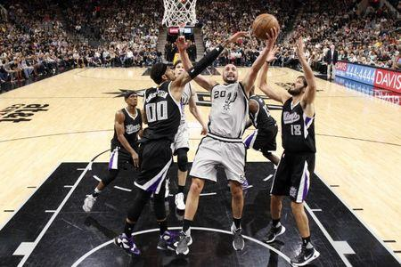 Mar 5, 2016; San Antonio, TX, USA; San Antonio Spurs shooting guard Manu Ginobili (20) shoots the ball as Sacramento Kings center Willie Cauley-Stein (00) and small forward Omri Casspi (18) defend during the second half at AT&T Center. The Spurs won 104-94. Mandatory Credit: Soobum Im-USA TODAY Sports / Reuters Picture Supplied by Action Images