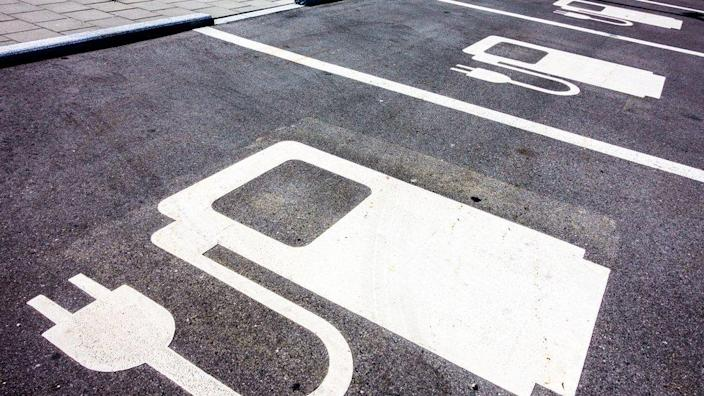 Generic image of electric car chargin bays in a parking lot