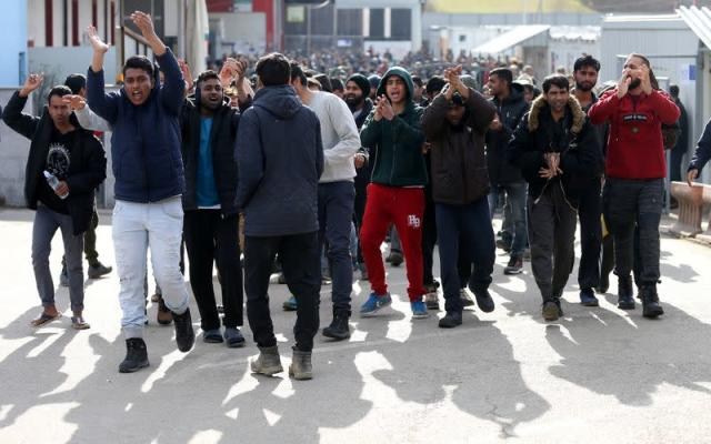 Migrants protest in front of the refugee camp Miral in Velika Kladusa
