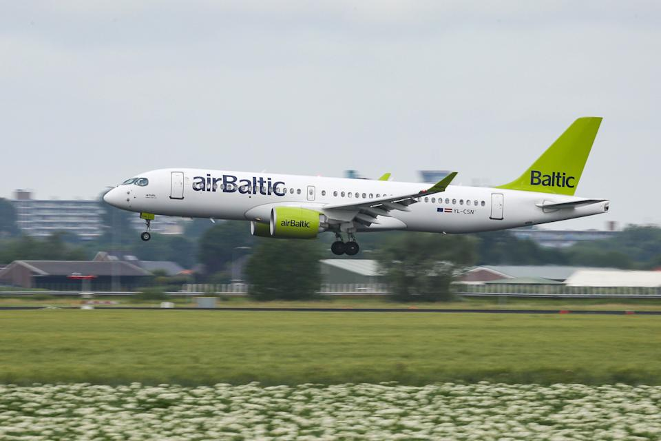 Air Baltic Airbus A220-300 aircraft as seen on final approach flying, landing and touching down at Amsterdam Schiphol International Airport in the Netherlands, on July 2, 2020. The new modern and advanced airplane has the reistration YL-CSN, the name Sigulda and is powered by 2x PW jet engines. AirBaltic BT BTI is the flag carrier of Latvia and is operating from the Latvian capital Riga an all Airbus A220 fleet, the former Bombardier CS300. he company temporarily suspended operations on 17 March 2020 due to the Covid-19 coronavirus pandemic with the quarantine and lockdown measures and flights only restarted on a limited basis from 18 May 2020. (Photo by Nicolas Economou/NurPhoto via Getty Images)