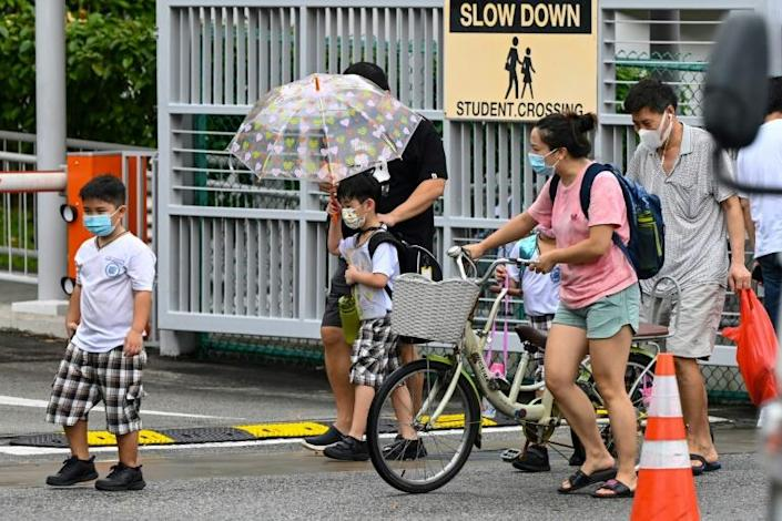 Singapore has tightened restrictions because of a fresh outbreak, including the closure of schools