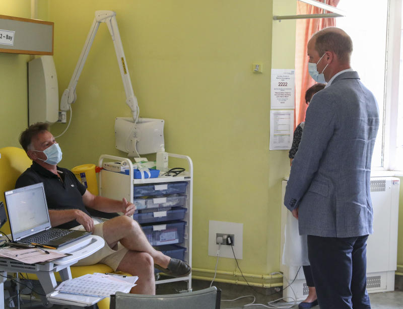 EMBARGOED: not for publication before 2200 BST Wednesday June 24, 2020. The Duke of Cambridge talks to a patient participating in the Covid-19 vaccine trial at the Oxford Vaccine Group's facility at the Churchill Hospital in Oxford during a visit to learn more about their work to establish a viable vaccine against coronavirus.