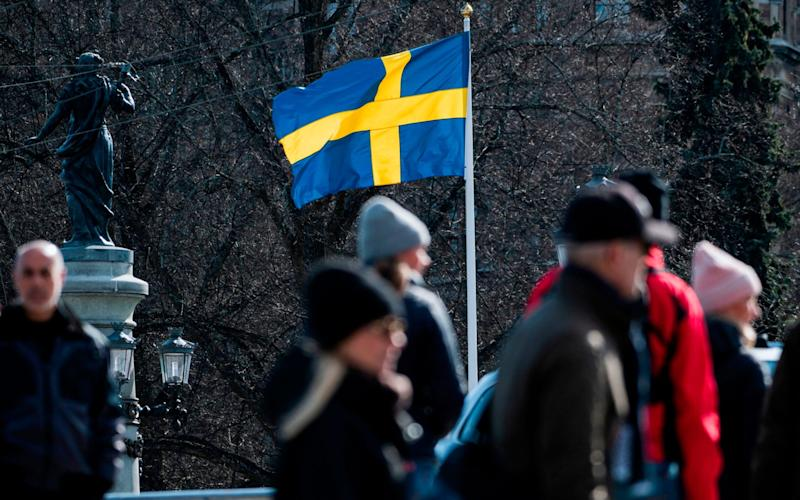 The Swedish flag is pictured in Stockholm during the the Covid-19 pamdemic - AFP