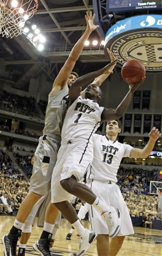 Pittsburgh's Tray Woodall (1) shoots as Oakland's Corey Petros, left, defends in the first half of the NCAA college basketball game on Saturday, Nov. 17, 2012 in Pittsburgh. Pittsburgh's Steven Adams is at right.(AP Photo/Keith Srakocic)