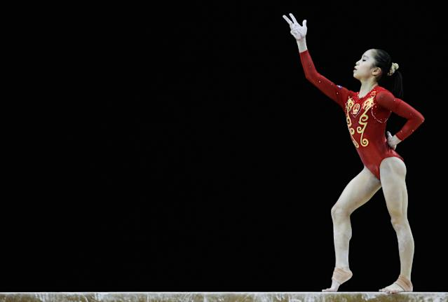 LONDON, ENGLAND - JANUARY 11: Yao Jinnan of China in action on the balance beam during the Women's Artistic Gymnastics Olympic Qualification round at North Greenwich Arena on January 11, 2012 in London, England. (Photo by Paul Gilham/Getty Images)