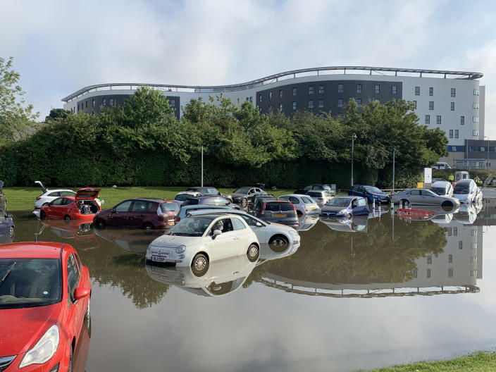 Flooding at Queen Victoria Hospital car park, in Kirkcaldy, Fife, Scotland. Thunderstorm warnings are still current for most of the UK on Wednesday, while high temperatures are forecast again for many parts of England.
