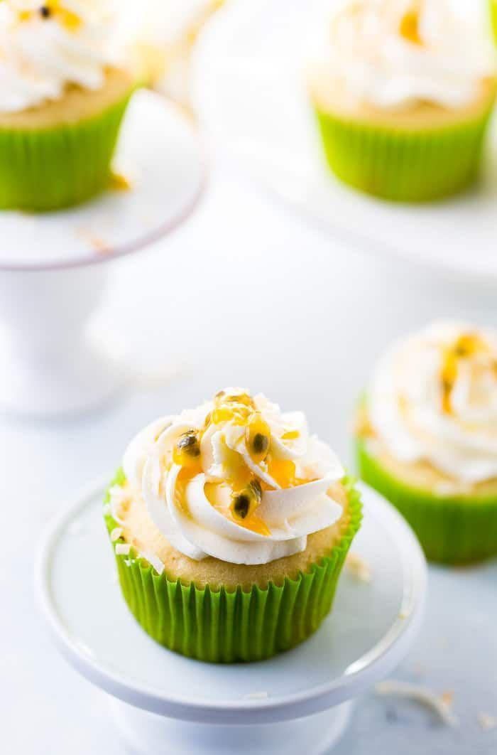 """<p>Bring a taste of the tropics to your summertime bash — coconut cream in the batter and a sweet-tart passionfruit curd will take you straight into vacation mode.</p><p><em><a href=""""https://aclassictwist.com/passionfruit-coconut-cupcakes/"""" rel=""""nofollow noopener"""" target=""""_blank"""" data-ylk=""""slk:Get the recipe from A Classic Twist »"""" class=""""link rapid-noclick-resp"""">Get the recipe from A Classic Twist »</a></em></p>"""