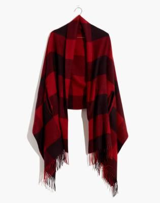 """<h3><a href=""""https://www.madewell.com/buffalo-check-cape-scarf-AE614.html"""" rel=""""nofollow noopener"""" target=""""_blank"""" data-ylk=""""slk:Madewell Cape Scarf"""" class=""""link rapid-noclick-resp"""">Madewell Cape Scarf</a></h3><br>Travel is a heated topic for R29 readers, <em>especially</em> where <a href=""""https://www.refinery29.com/en-us/travel-outfits"""" rel=""""nofollow noopener"""" target=""""_blank"""" data-ylk=""""slk:outfits"""" class=""""link rapid-noclick-resp"""">outfits</a> and <a href=""""https://www.refinery29.com/en-us/best-travel-accessories"""" rel=""""nofollow noopener"""" target=""""_blank"""" data-ylk=""""slk:accessories"""" class=""""link rapid-noclick-resp"""">accessories</a> are concerned — a consistent top-carted essential for flying is one of Madewell's cape scarves. And this chic seasonal style is currently on sale for 30% off. <br><br><strong>Madewell</strong> Buffalo Check Cape Scarf, $, available at <a href=""""https://www.madewell.com/buffalo-check-cape-scarf-AE614.html"""" rel=""""nofollow noopener"""" target=""""_blank"""" data-ylk=""""slk:Madewell"""" class=""""link rapid-noclick-resp"""">Madewell</a>"""