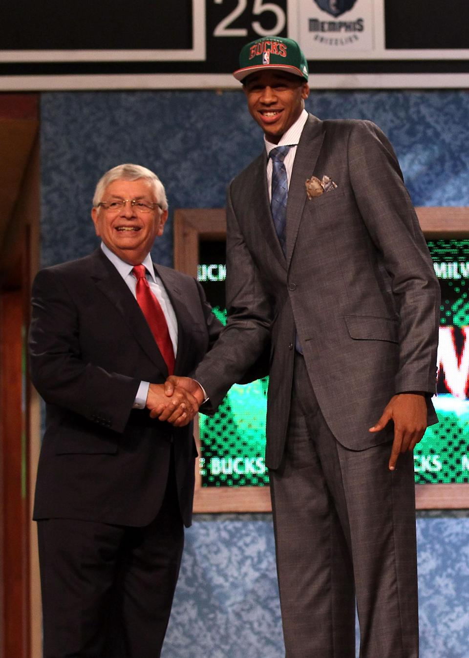 NEWARK, NJ - JUNE 28: John Henson (R) of the North Carolina Tar Heels greets NBA Commissioner David Stern (L) after he was selected number fourteen overall by the Milwaukee Bucks during the first round of the 2012 NBA Draft at Prudential Center on June 28, 2012 in Newark, New Jersey. NOTE TO USER: User expressly acknowledges and agrees that, by downloading and/or using this Photograph, user is consenting to the terms and conditions of the Getty Images License Agreement. (Photo by Elsa/Getty Images)