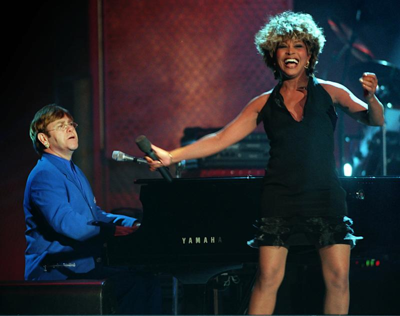 Tina Turner and Elton John perform a duet during the VH1 Fashion & Music Awards show in New York Sunday, Deec. 3, 1995. (AP Photo/Adam Nadel)