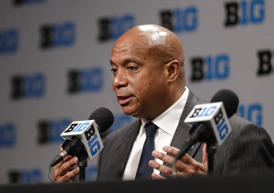 FILE - In this March 12, 2020, file photo, Big Ten Commissioner Kevin Warren addresses the media in Indianapolis after it was announced that the remainder of the Big Ten Conference men's basketball tournament had been canceled. Warren, the first black commissioner of a Power Five conference, is creating a coalition to give the league's athletes a platform to voice their concerns about racism. Warren announced Monday, June 1, 2020, the formation of the Big Ten Anti-Hate and Anti-Racism Coalition, with athletes, coaches, athletic director and university chancellors and presidents. (AP Photo/Michael Conroy, File)