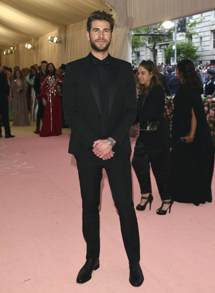 """FILE - Liam Hemsworth attends The Metropolitan Museum of Art's Costume Institute benefit gala celebrating the opening of the """"Camp: Notes on Fashion"""" exhibition on May 6, 2019, in New York. Hemsworth turns 31 on Jan. 13. (Photo by Evan Agostini/Invision/AP, File)"""